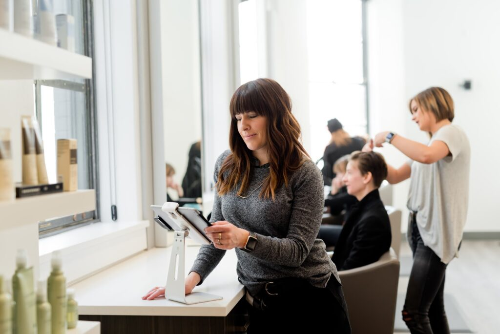 Using a tablet at a salon.